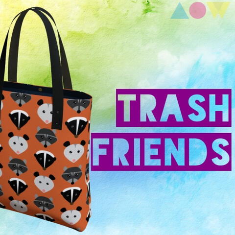 """Trash Friends"" tote bag with alternating opossum, raccoon, and skunk faces on an orange background."